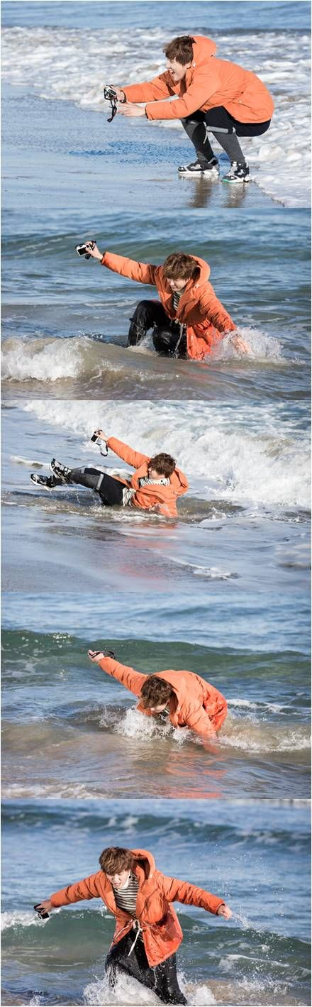Yoon Shi Yoon was seen falling into the ocean with a camera in his hand and made people laugh.