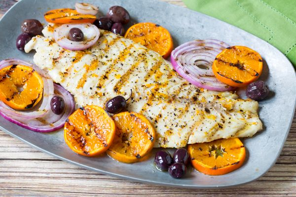 Italian inspired grilled grouper. A grilled fish dish with grilled oranges, onions and olives. Bold flavor and light on the waistline.