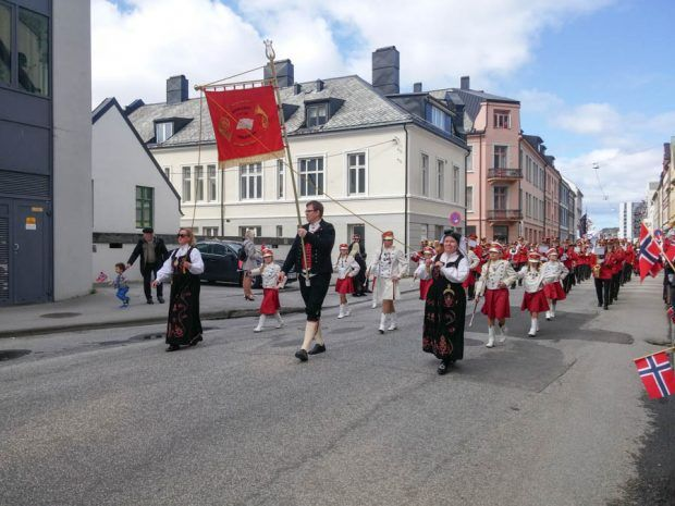 Norwegians celebrate the signing of their constitution on May 17, 1814 with a children's parade lead my marching bands. This holiday more commonly known as 17 mai features beautiful outfits and the traditional dresses in Norway called the bunad. | carenshope.com