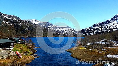 A lovely view of the Norwegian fjords with clouds water and islands