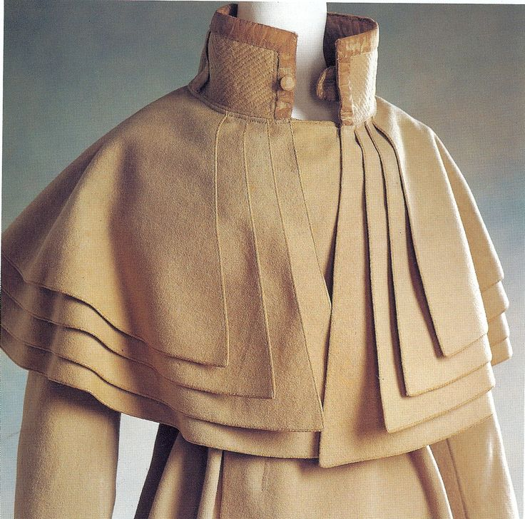 Cleric Coat. Originally a livery coat for coachmen it later became a fashion item in the late 18th century. This elegant example dates from the 1820-30s (it is said to have belonged to a woman but the way the buttons close suggest it may have more likely belonged to a man)