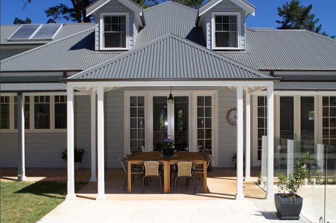 grey with white trim and dark roof