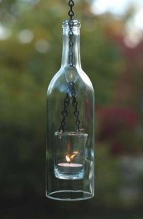 Using a glass cutter, chain & a votive make this a great outdoor sense of  ambiance