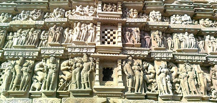 Three layered design with sculptures carved out on every layer. Most of the temples of Khajuraho has similar type of sculptural design.