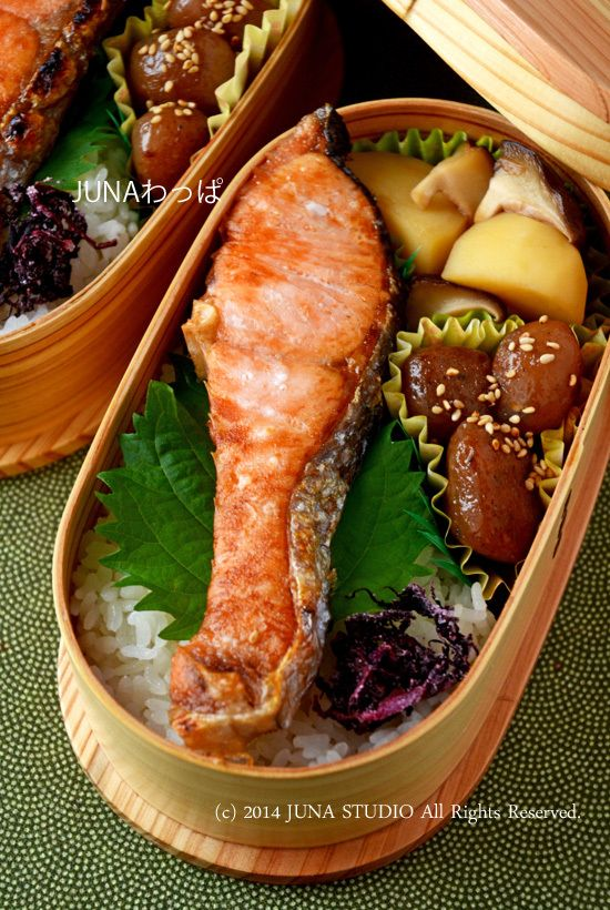 I like the use of shiso leaf under the salmon, and the cupcake cups to store little dishes.