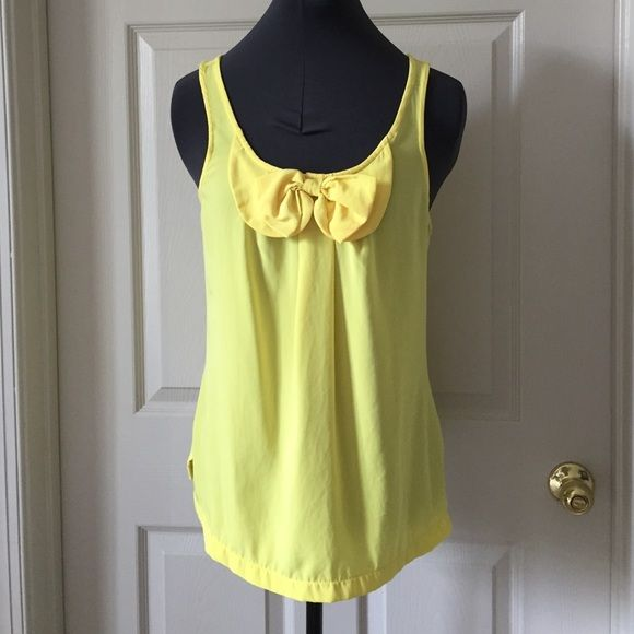 Banana Republic yellow tank top with bow detail Super cute bow on the front of this bright yellow tank top. Flowy and super comfortable all while looking cute! Banana Republic Tops Tank Tops