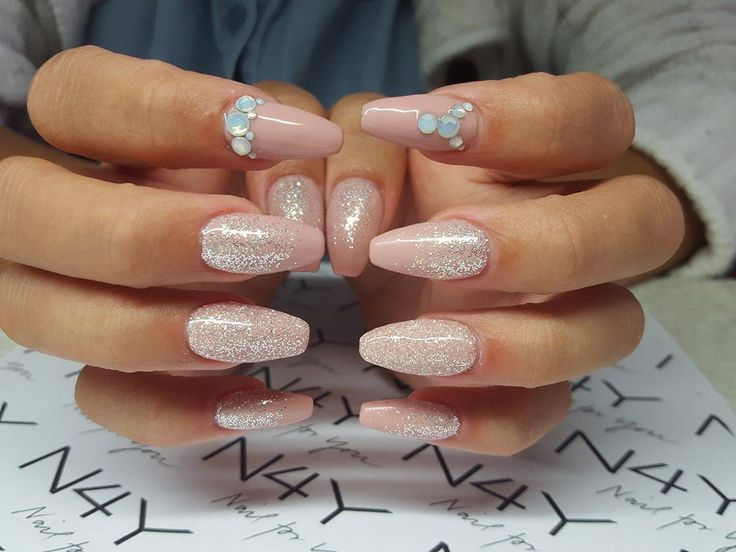 Gel Nails with nail art glitter and rhinestones in soft pink