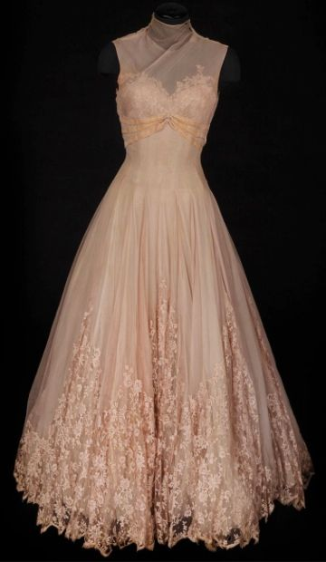 1956 ~ Pale pink chiffon and lace gown with velvet accents. Designed by Helen…