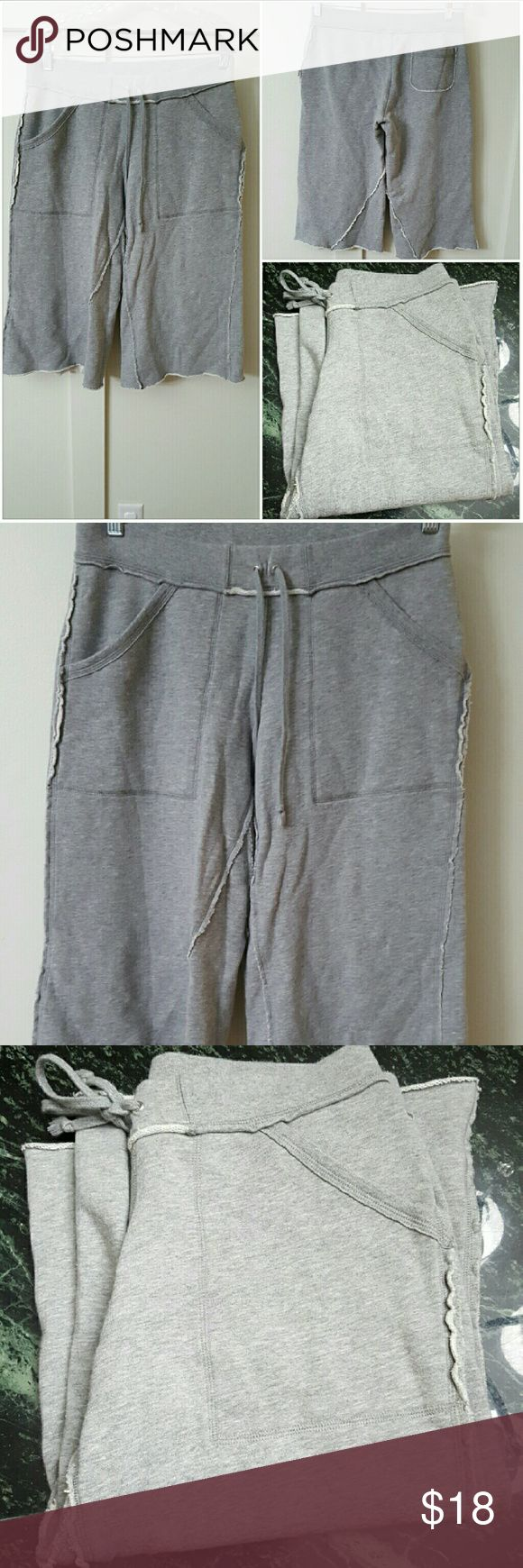 BANANA REPUBLIC SMALL GRAY DISTRESSED SHORTS Banana Republic small gray long shorts. Distressed as part of the design. Fake front tie. Pre-owned and in good condition. 100% Cotton Banana Republic Shorts