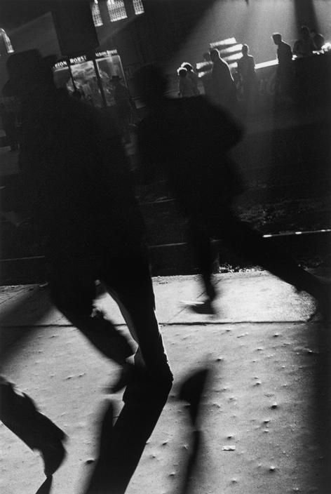 People running to catch the train on evening. Argentina, 1957.    by Sergio Larrain