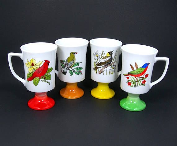 Wonderful set of 4 Fred Roberts china coffee mugs with colorful bird designs on them - Pedestal cups each have a different colored base: Red, yellow, orange, green - Mugs hold 8 ounces - Four different bird designs (same design on both sides of each mug) - Vintage 1960-70s - Made in Japan - Bird Lovers All are in excellent condition with no chips or cracks or wear to the paint on either bird designs or the foot of the mugs. Package will weigh 3 pounds and will ship USPS in a priority…