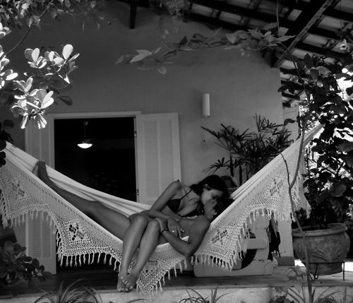 Hammocks are a fabulous way to spend lazy afternoons and use outdoor spaces which are small and potentially tucked away... Love in the great outdoors is another great use for hammocks :)