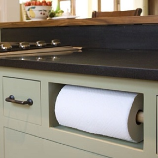 Genius. Paper towel roll in spot of faux kitchen drawer!