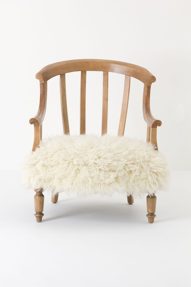 The tiniest chair for the tiniest little sheep! I love how silly this chair is.    Flokati Garvey Chair - Anthropologie.com