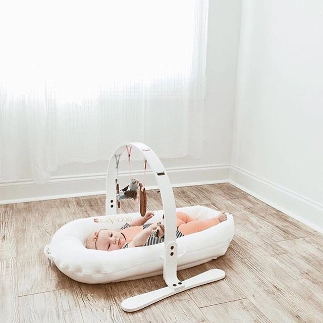 Perfect playtime pairing. Dockatot baby lounger with all new white wooden playgym from Finn & Emma.