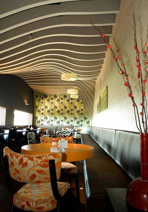 Modern restaurant interior design with ceiling decoration