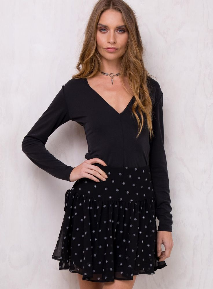 The+Fifth+Midnight+Memories+Skirt+-+Midnight+Memories+Skirt+by+Fifth+the+Label Flared+mini+skirt High+rise+fit Panel+detail+in+skirt Mock+ties+at+sides Invisible+zip+at+back Sheer+material+with+daisy+print Fully+lined 100%+Polyester Avril+is+wearing+a+size+8