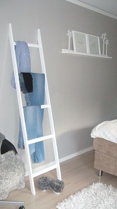I like this idea for a place to throw clothes when you don't have time to put them away.
