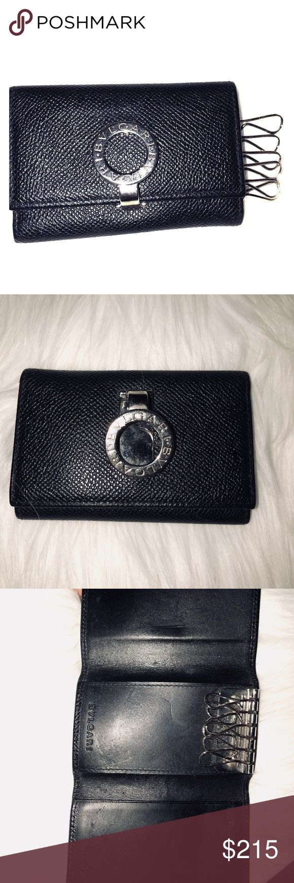 ♥️BVLGARI 6 key Holder/Case♥️ Preowned - shows wear from normal use- leather o Inside is soft and has some marks and scuffs from keys being attached and closed.. black leather with silver hard wear - metal has some hairline scratches. Outside still in very good condition doesn't have any major flaws- inside shows it's has been used. Item is preowned so please don't expect a new item- see all pics before purchasing Bulgari Accessories Key & Card Holders