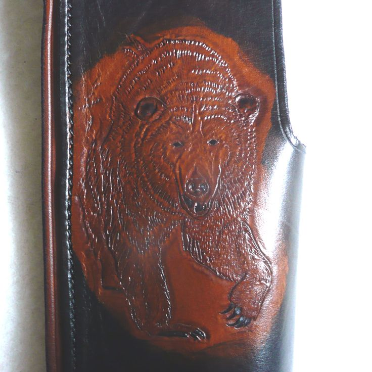 """Hand carved Grizzly on front of our Mare's Leg Rig """"Grizz"""". YOU DREAM IT - WE MAKE IT!"""