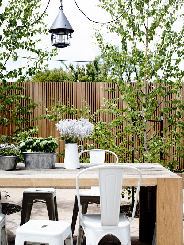 wood outdoor with variety of metal chairs