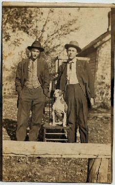 Two duded up men and their Pit Bull. I like this photo. It reminds me that at one time the majority of Americans lived in rural environments and were listed on the census as 'farmers'. It also reminds me that at one time, if they weren't doing labor, men wore a suit and tie.