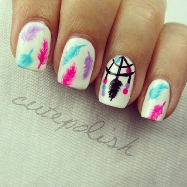 Cute feather themed watercolor nail art design. Paint your nails in white as base color and add multi colored feathers falling on top of the nails. You can also add details such as a necklace of feathers using black nail polish.