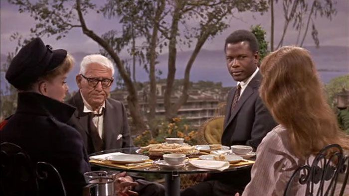 "Spencer Tracy, Sidney Poitier, Katherine Hepburn and Katharine Houghton in ""Guess who's coming to dinner"", directed by Stanley Kramer and released on December 12, 1967."
