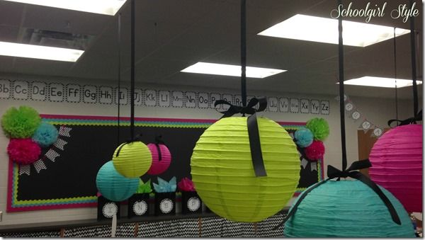Lime green, hot pink, turquoise, and black and white chevron make for an adorable and stylish classroom decor.