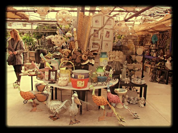 Large watering cans, angel frame, tiny fountain