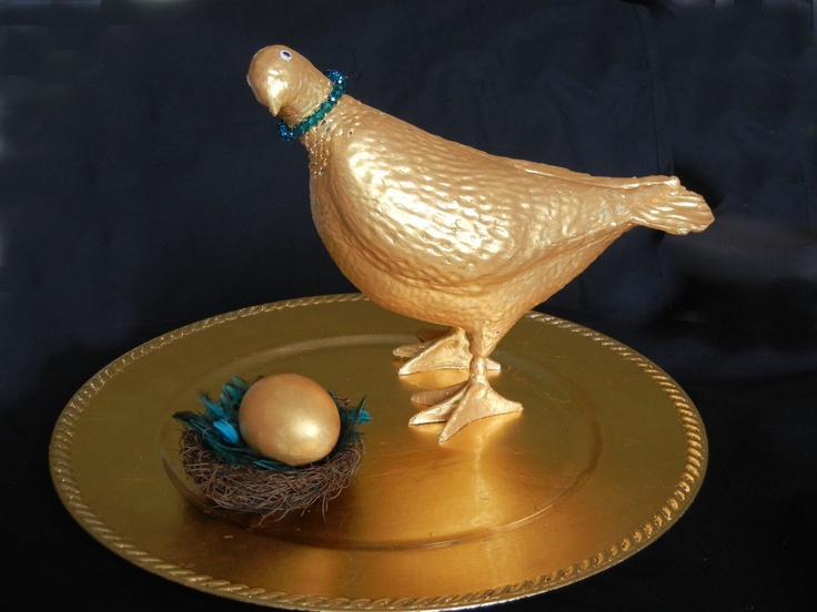 "At the Parks Mall in Arlington, TX many small pigeon statues were donated to be redecorated, then auctioned off in November to benefit River Legacy Park.  Each Canvas by Canvas artist selected a pigeon to repurpose - ""Golden Girl "" is the contribution of artist Elizabeth Mitchell Taylor - This pretty gold pigeon looks like she has laid a giant goose egg. Nestled in soft turquoise feathers on a golden platter, the egg may just hatch soon!"