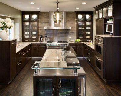 Mmm.. Dark wood cabinets! I love the glass bar.