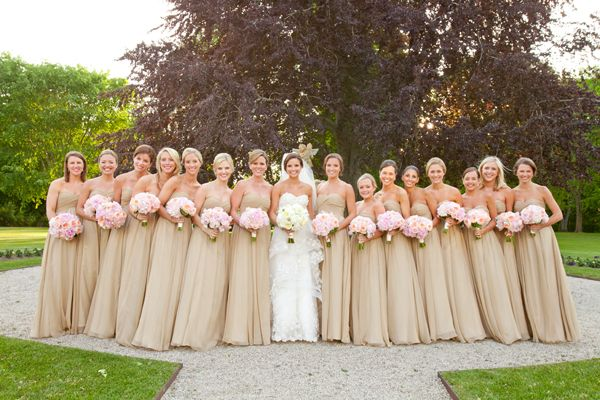 One trend from this past season, that we already see making it's way into the Fall season is champagne colored bridesmaid dresses! If you think about it they are perfect for every season.  Champagne is such a neutral color that it is adaptable to any season! All you have to do is change the accessories.  One more plus, they compliment the brides dress perfectly. Just take a look for yourself…   Will you have champagne colored bridesmaid dresses at your wedding? Send us  photo!