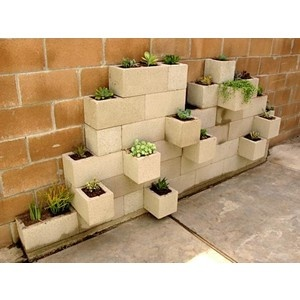 Cinder block gardening.  Would look good if tiled over???