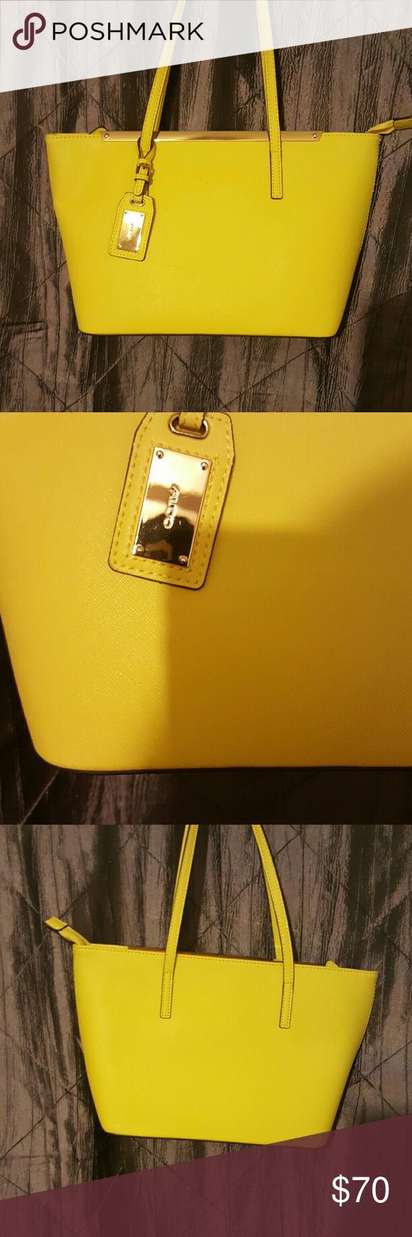 Aldo purse yellow gold purse medium size.   used 1 time to small for me. Aldo Bags Baby Bags