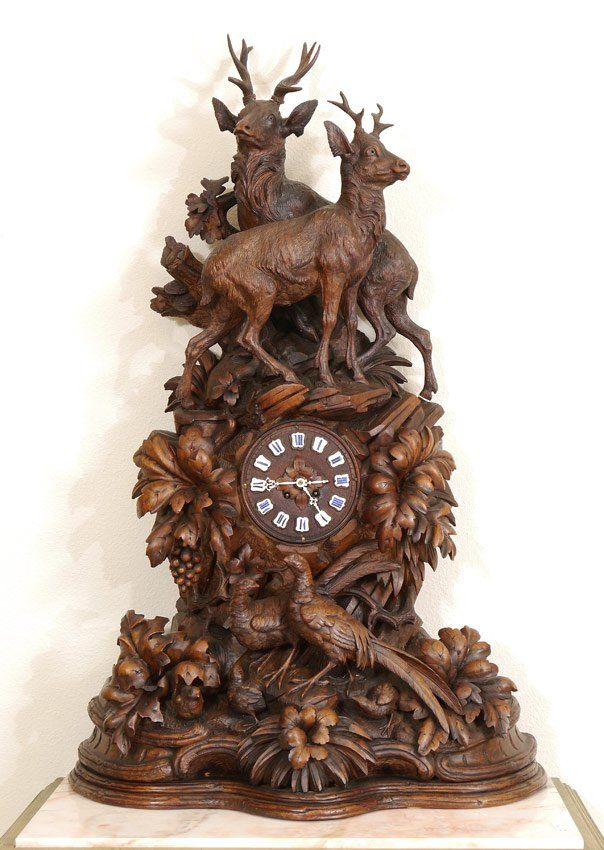 Monumental Black Forest Carved Mantle Clock.