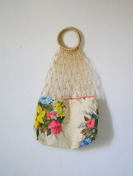 Net shopping bag by Copirates. So granny, so green. It's sisal not raffia, but it fits the board.