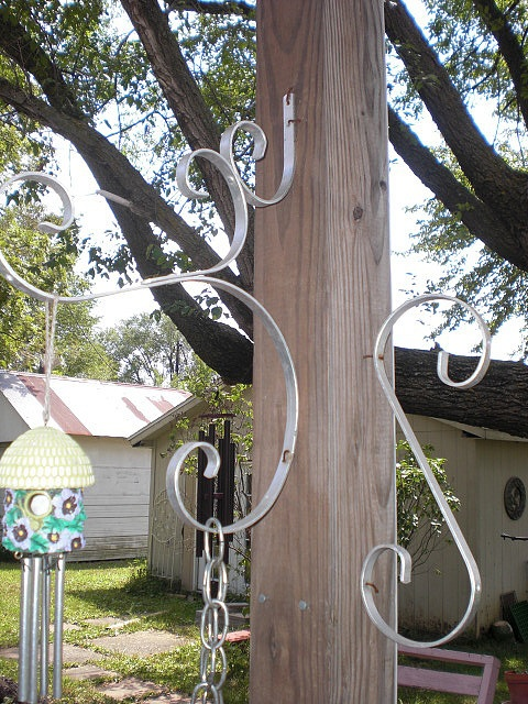 Upcycled screen door grill as yard art