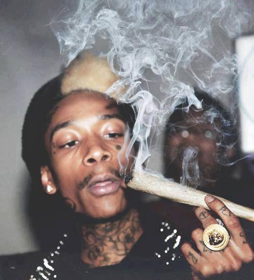 Wiz Khalifa with a jumbo joint