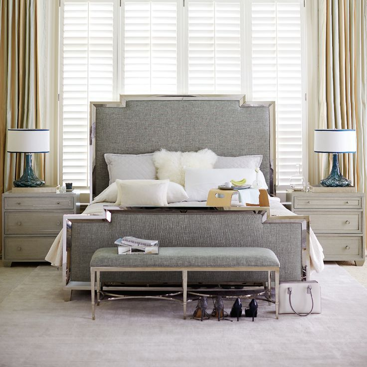 It doesn't get much more glamorous than this Bernhardt bedroom with an upholstered bed with mirrored trim. Find everything you need for your perfect bedroom at West Coast Living