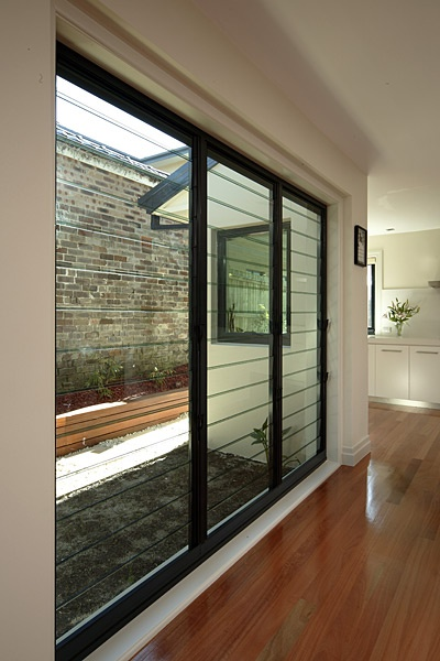 Triple louvres on internal staircase landing, facing north. Exact same install, but in black not alu. Stegbar photo library - Aluminium windows and doors