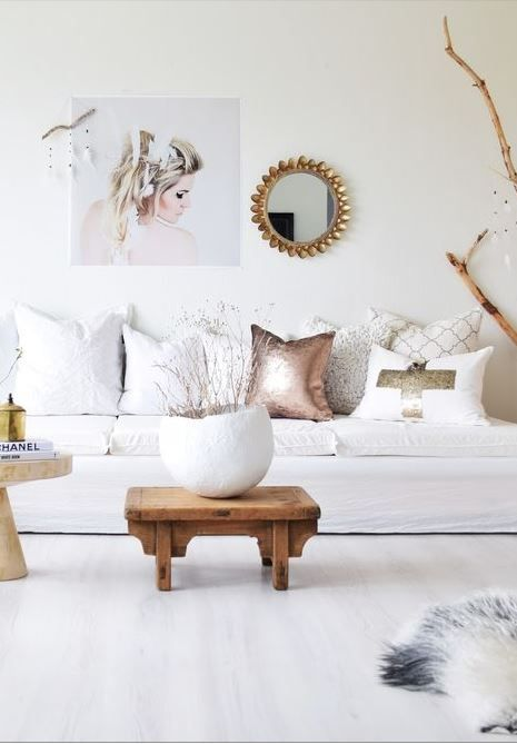 Not a fan of this decor; but I do like how the whites in the room show off the whites in the image (wedding photos would go great with a white fur throw on a grey sofa for example)