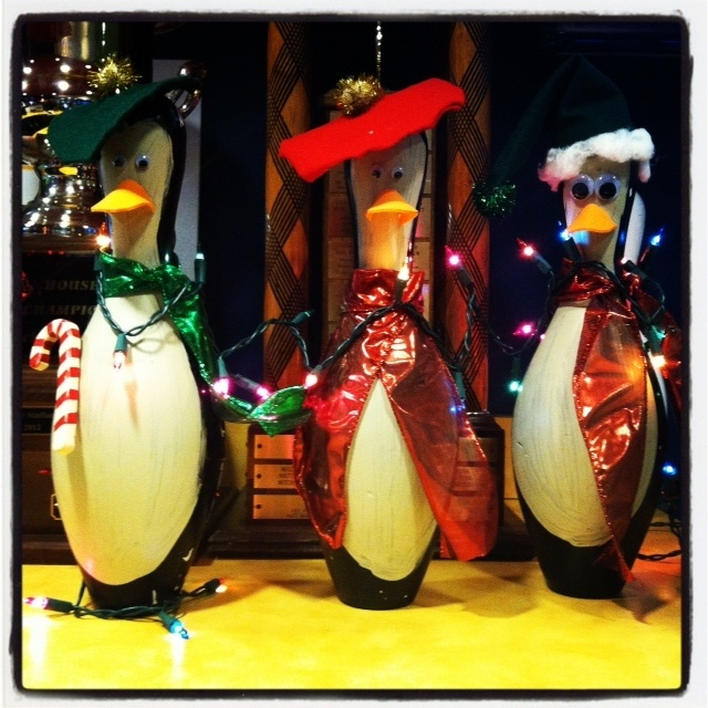 Bowling pins converted into penquins for the holiday