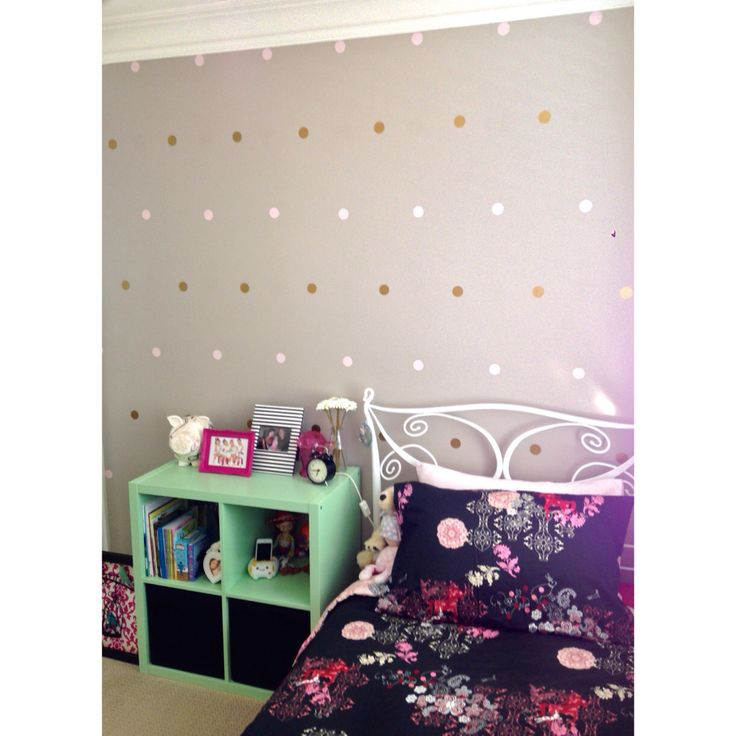 Polka dot wall decals. Dulux Blind Date paint used on feature wall.