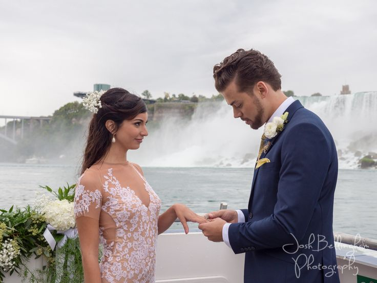 Niagara Falls Wedding Ceremony Under The Falls. Groom saying his vows and putting the ring