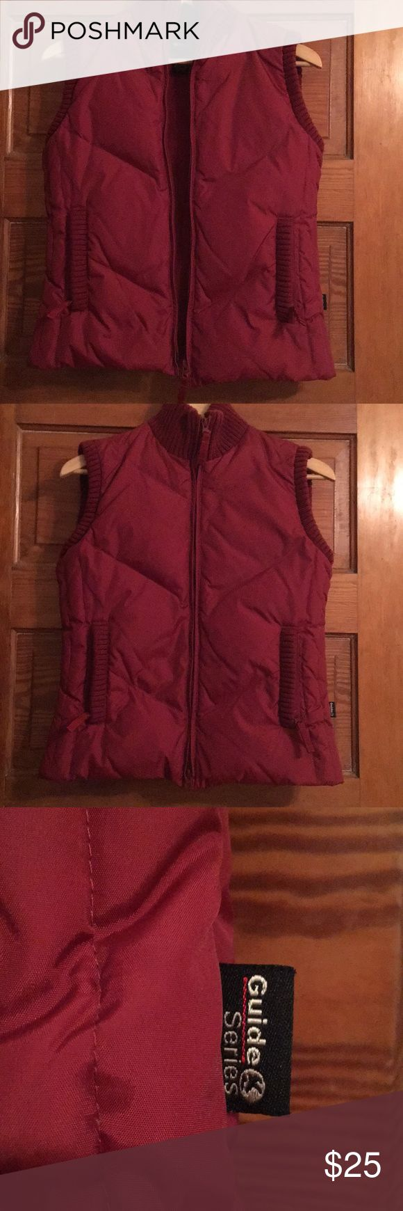 Guide Series Gander Mountain goose down vest Guide Series Vest in a beautiful deep red Very warm with 75% goose down fill Pre- owned, but in good shape.  See pics for both the inside and outside.  There is a little piling on the knit lining the armholes and pockets. Very slight.  Marked size s  Measurements  Pit to pit almost 18 inches  From the zipped up collar to hem 23 inches Gander Mountain Jackets & Coats Vests