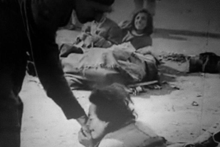 Rosalie Weisner, survivor of Belsen Concentration Camp, kisses the hand of her liberator. 15th of April, 1945*