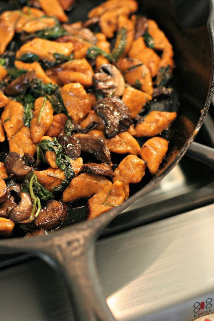Homemade Sweet Potato Gnoochi, tossed with savory mushrooms, sautéed spinach and fresh rosemary! ~vegan~