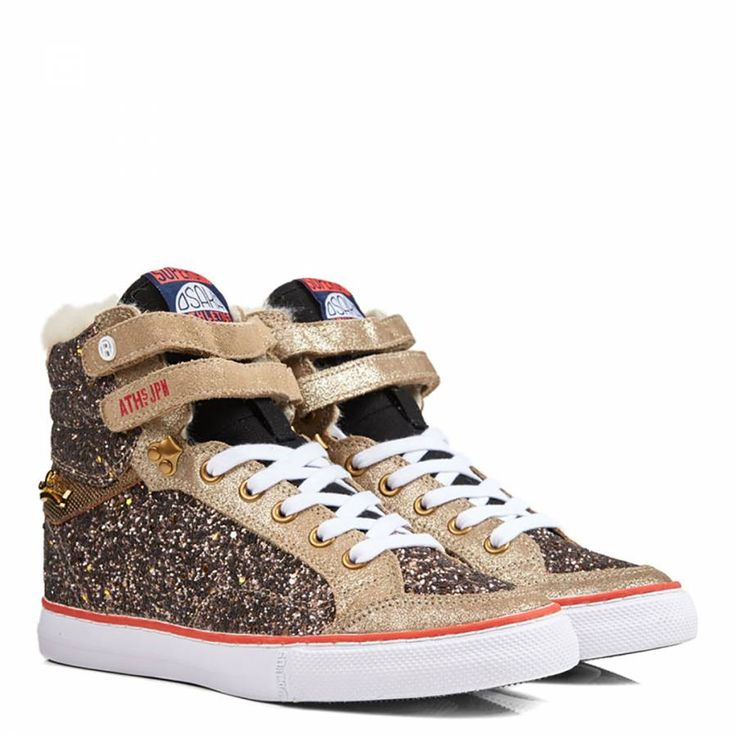 This is the perfect shoe to add style and practicality to your autumn attire this upcoming seasonHigh top glitter trainersLeather insertsLace fasteningSuperdry branded tongueFaux fur trimAdded ankle strapsColour: champagne/goldUpper: 47% polypropylene, 30% leather, 23% cottonLining and sock: 60% cotton, 32% acrylic, 8% polyesterSole: 100% rubberCare: wipe cleanSize guide for footwear as follows:UK: 2, US: 4, European: 35UK: 3, US: 5, European: 36UK: 4, US: 6, European: 37UK: 5, US: 7, Eu...