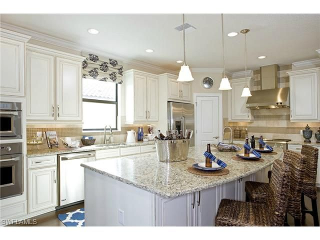 White coastal kitchen | Taylor Morrison model home in the Amador neighborhood of Fiddlers Creek | Naples, Florida